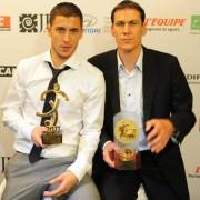 Eden Hazard proudly showing his Best Player Award with coach Garcia