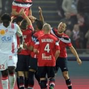 Eden Hazard (up) is celebrated by his Lille teammates in his last match in 2011.