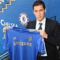 Nicely shaved and with a suit and tie, Eden proudly presents the shirt he will be wearing for the next 5 years.
