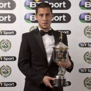 Eden Hazard posing for his award of Best Players